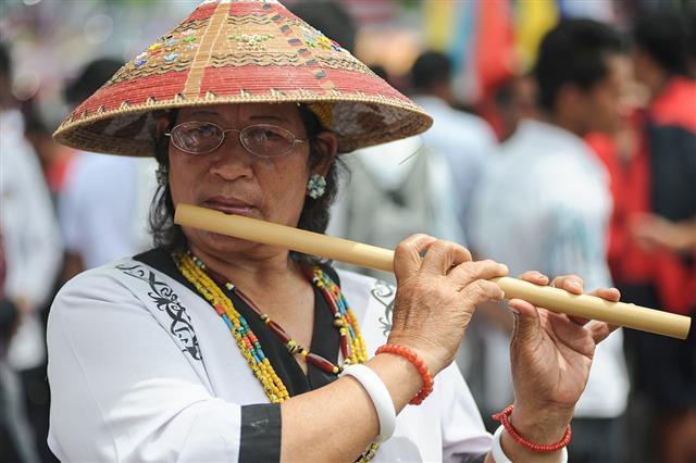 Lady Playing Bamboo Blute